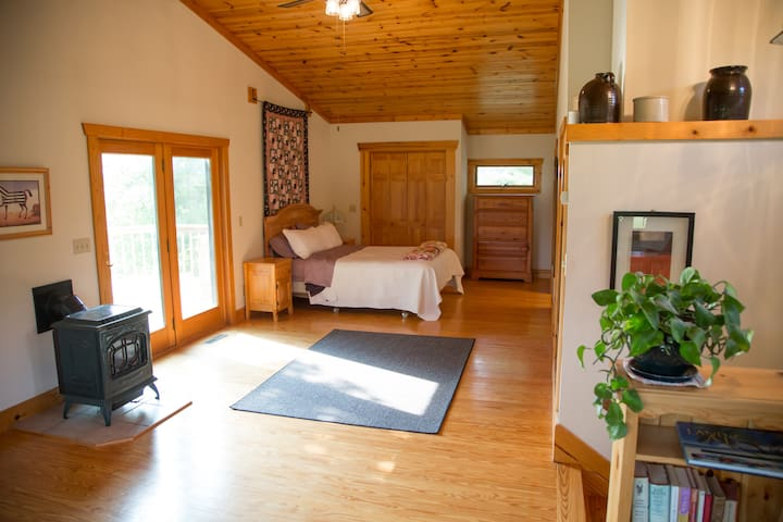 The Master Bedroom Loft (queen bed) has an attached bathroom and balcony, reading nook, desk, and additional daybed (with trundle bed).
