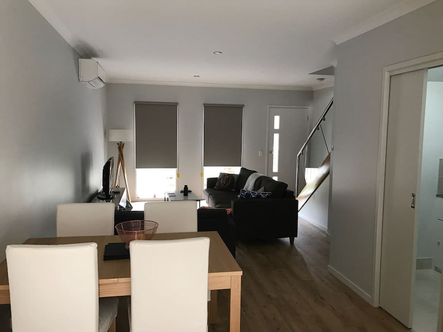 Living and dining area with laundry and additional toilet