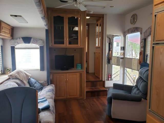 Large living space with comfortable full size couch that has a queen size pull out bed. Comfortable rocking recliner and entertainment area with TV and DVD movies plus cards and board games!