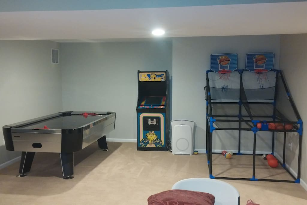 Family Room game area (air hockey, Ms Packman video game, and basketball game)