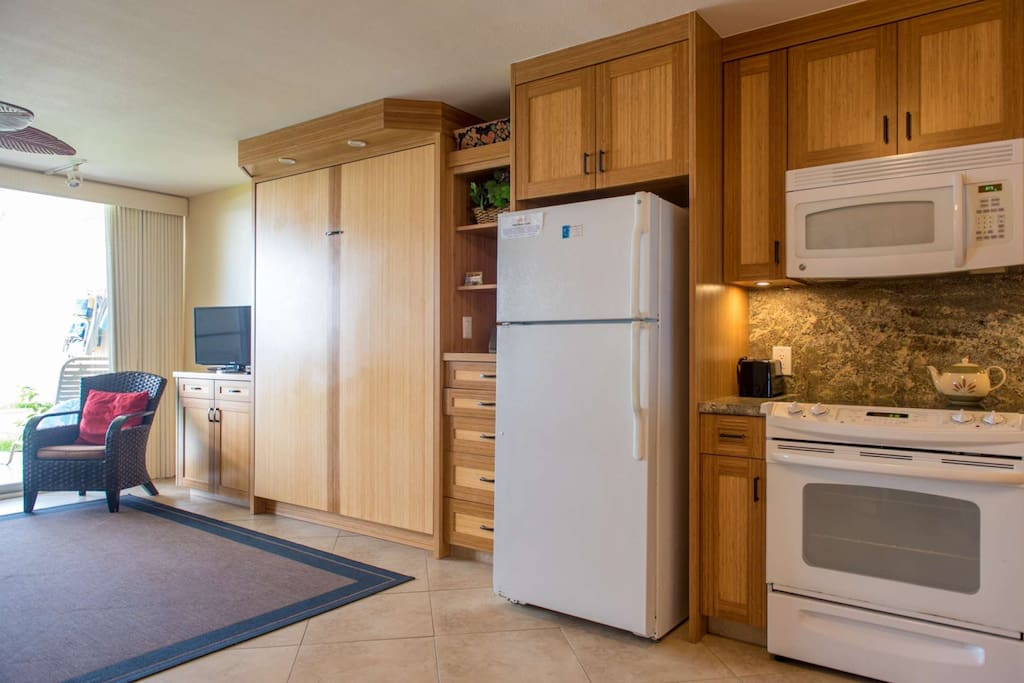 Full sized appliances in upgraded kitchen.