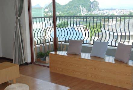 在桂林可看漓江、看山景的安静旅舍,简约独立房间(大床间) - Guilin - Huoneisto