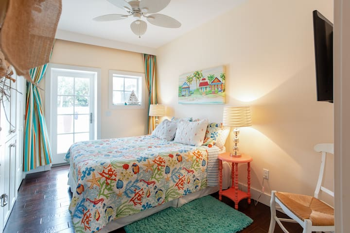 The main floor guest room has access to the beautiful outdoor oasis.