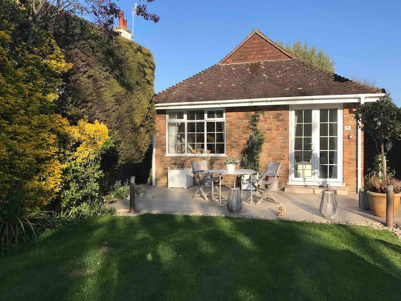 The bungalow has its own patio which is a quiet area to enjoy a meal in the sun or views of the pretty garden.