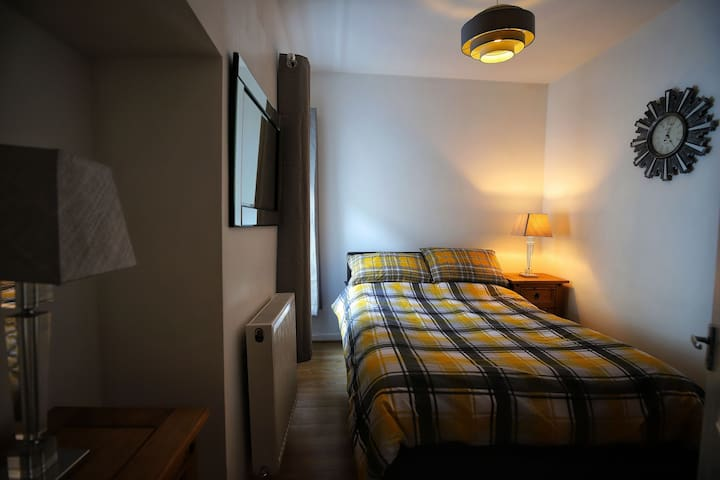 The Double room with views to the rear of the Property. We have fitted a Quality mattresses to give you a good nights sleep with double wardrobe and 2 chest of drawers for your storage needs.