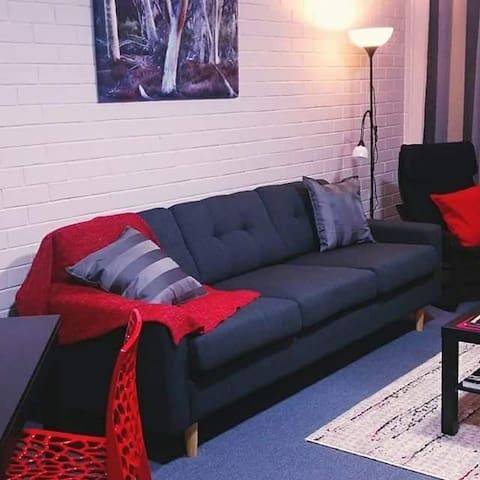 Living room in our red apartment.