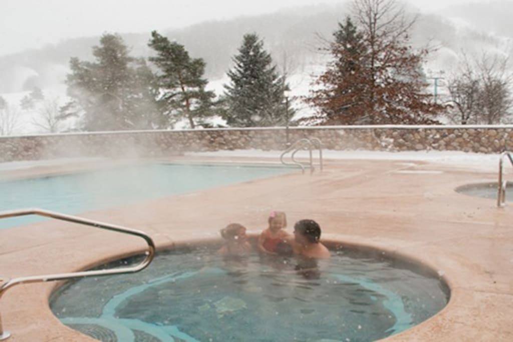 Indoor/outdoor pool and hot tubs open year round, yes even in the winter!