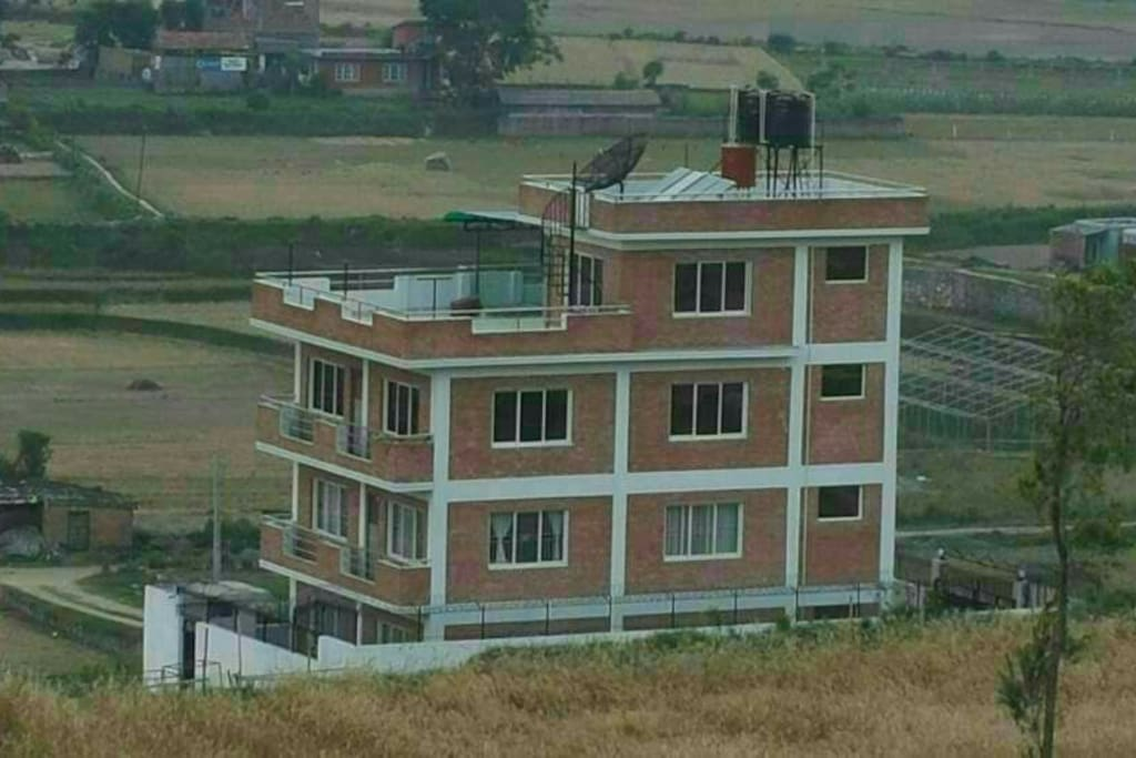 Private house in a well-maintained. Extremely clean, newly constructed building; resort-style house in a hill with a great view of hatiban and himal.   2nd floor (100sqm) of the building is open for airbnb guests.  Peacefully away but only 10 minutes ride from the center of Kathmandu city.    Cooking is available. Restroom with hot-water.  Free WiFi.