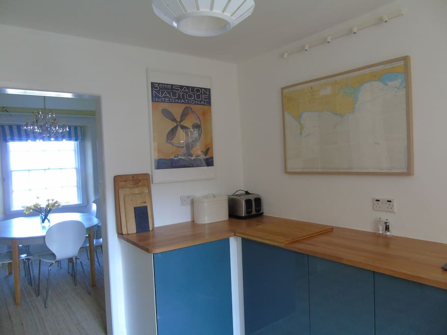 The brand new, well equipped kitchen leads into the dining room which has wonderful sea views.