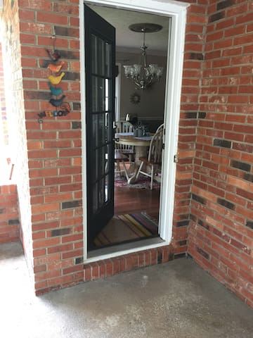 carport where guests park and keyless entry into private space