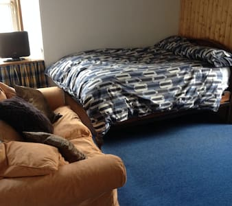 Queen size double bed in spacious bedroom - Nairn