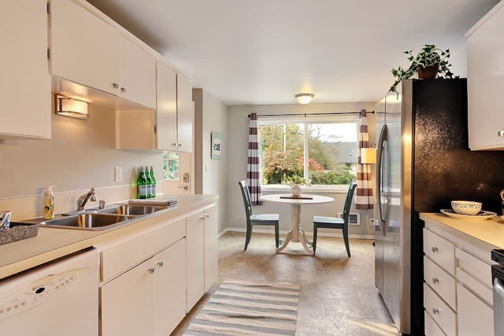 Cozy kitchen with eat in space. Stocked with everything you need for short or long term stays.