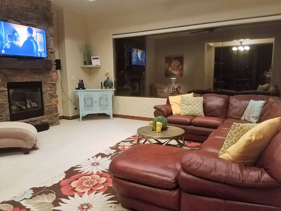 """Large comfy TV room with 55"""" TV, surround sound"""