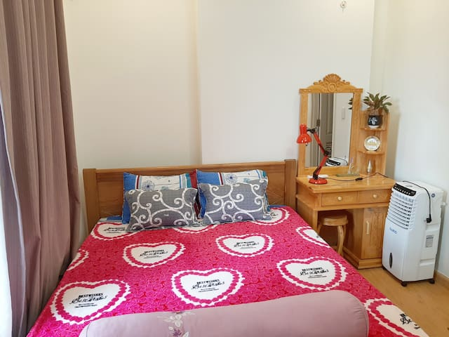 Bedroom 1 has 1 queen bed and 1 dressing table or working table. This room has a hairdryer and an iron.