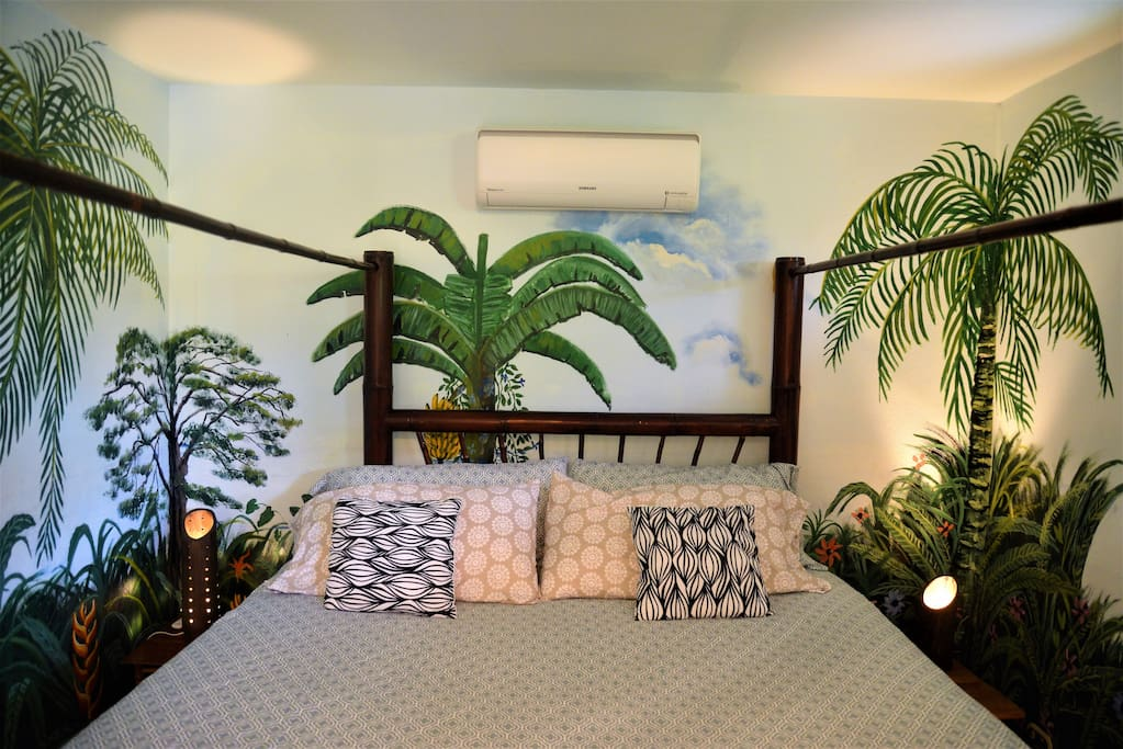 """Our """"Jungle"""" themed Master featuring 4"""" Memory Foam KING BED, AC & Master Bath"""