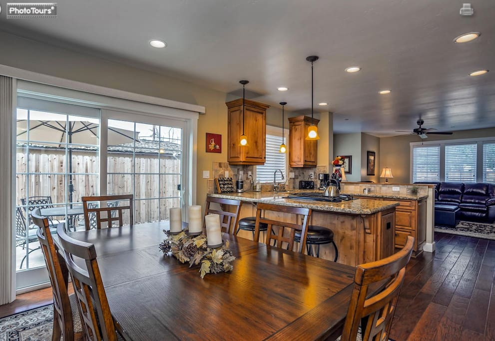 Open kitchen and dining area. Granite counter tops & engineered wood floors.