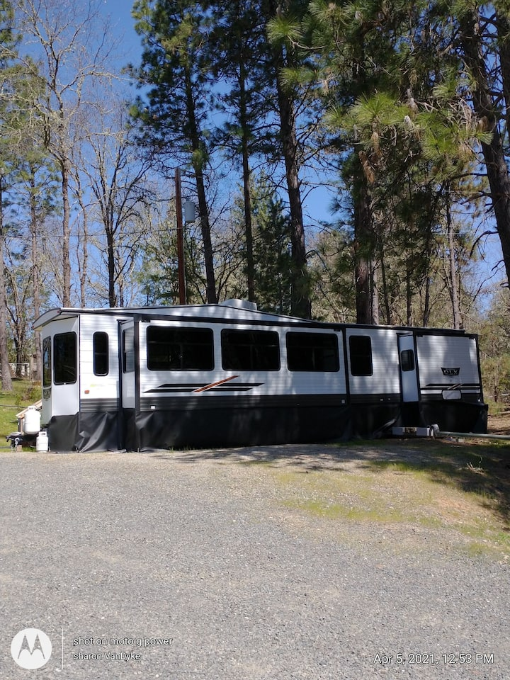 Nice 40 ft Parkside RV with slideouts and deck.
