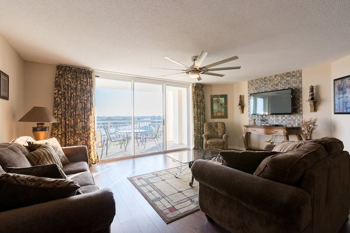 Large Flatscreen & a Jumbo sized Living area with a Waterway view