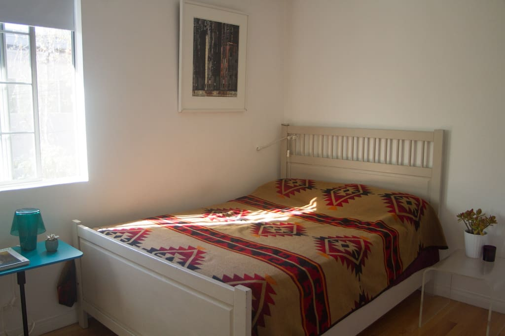 2nd Bedroom with full bed and bathroom across hall