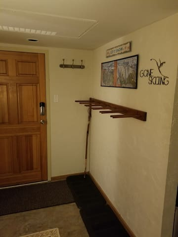 Ski/snowboard rack area inside door