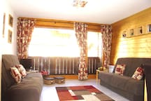 Living area with 2 double bed-settees