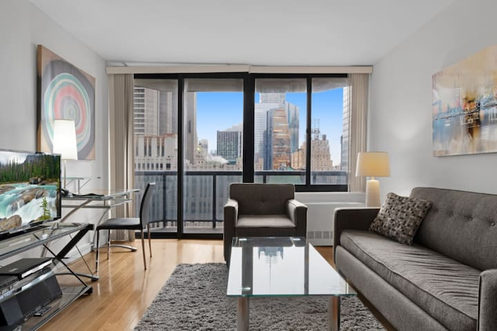 Midtown West 1BR | Full Kitchen + Balcony | by GLS