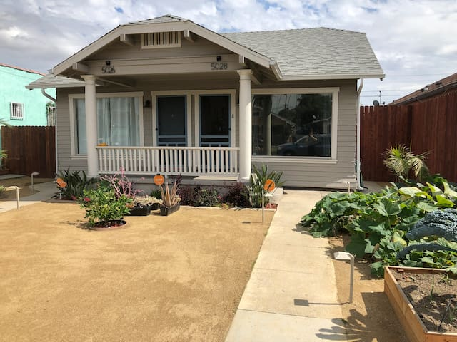 The Denker House front yard features 2 organic vegetable gardens, palm trees and fruit trees (Haas Avocado, Meyer Lemon, Pomegranate). It's very well-lit with high end landscape lighting, and an advanced security alarm system for added peace of mind.