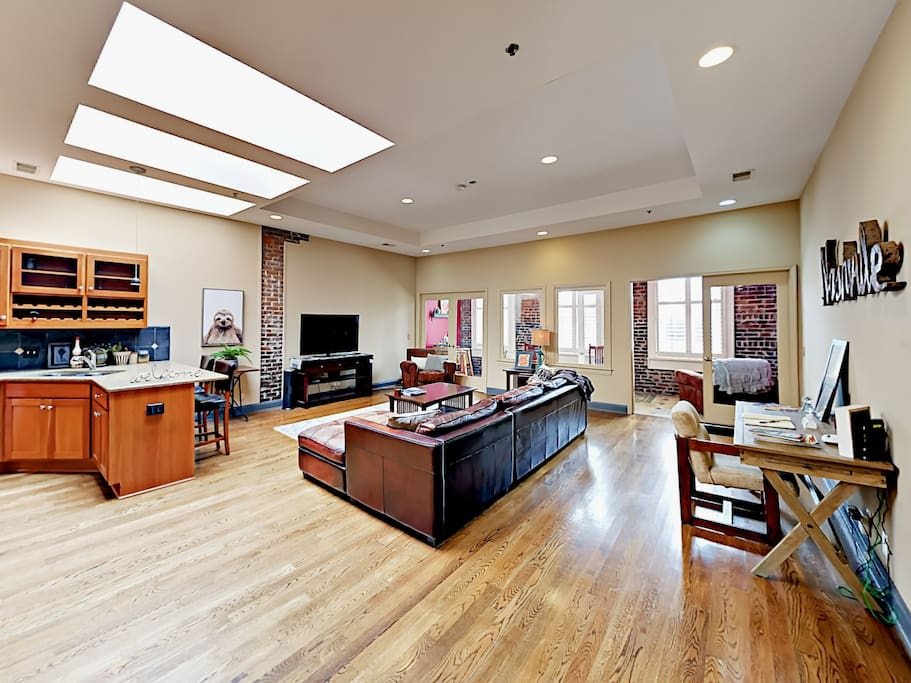 Kick back in the spacious living room with stylish exposed brick and luminous skylights.