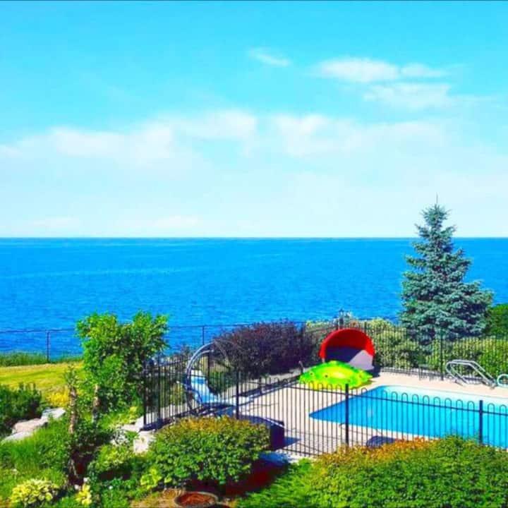 Enchanting Lakefront villa with Pool & blue Views!