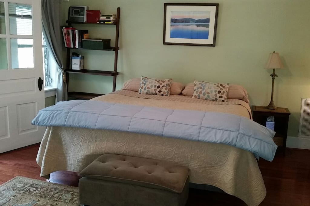 Spacious master bedroom with new king bed, sun-room just off master