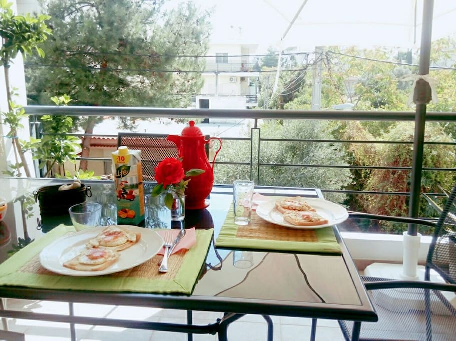 enjoy your meal at the beautiful blooming balcony