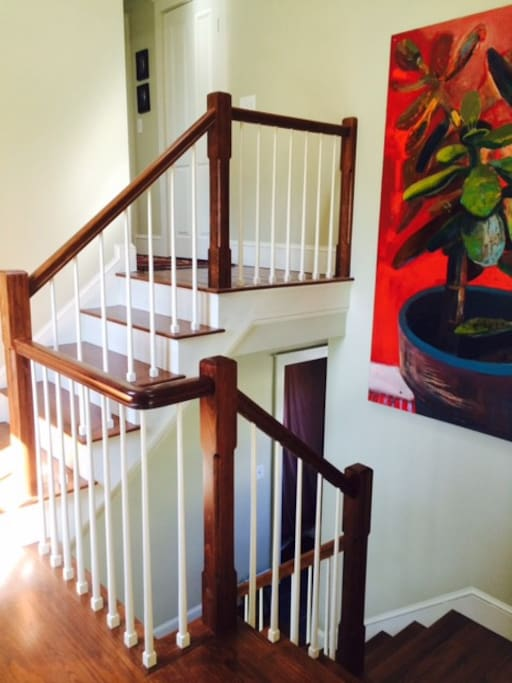 Stairwell between room for rent and master bathroom.