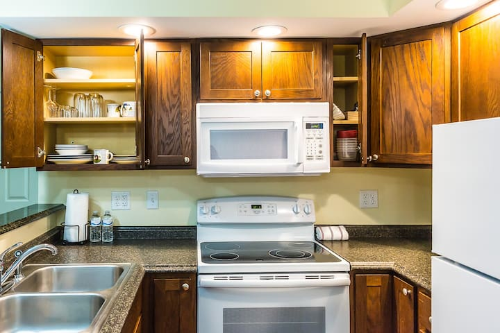 Fully equipped kitchen w/ new cabinets, appliances & starter soap packs provided upon arrival.