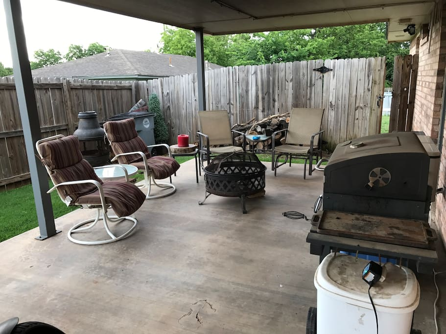 Outdoor sitting area with fire pit and BBQ