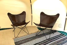 Leather butterfly chairs in the tent.