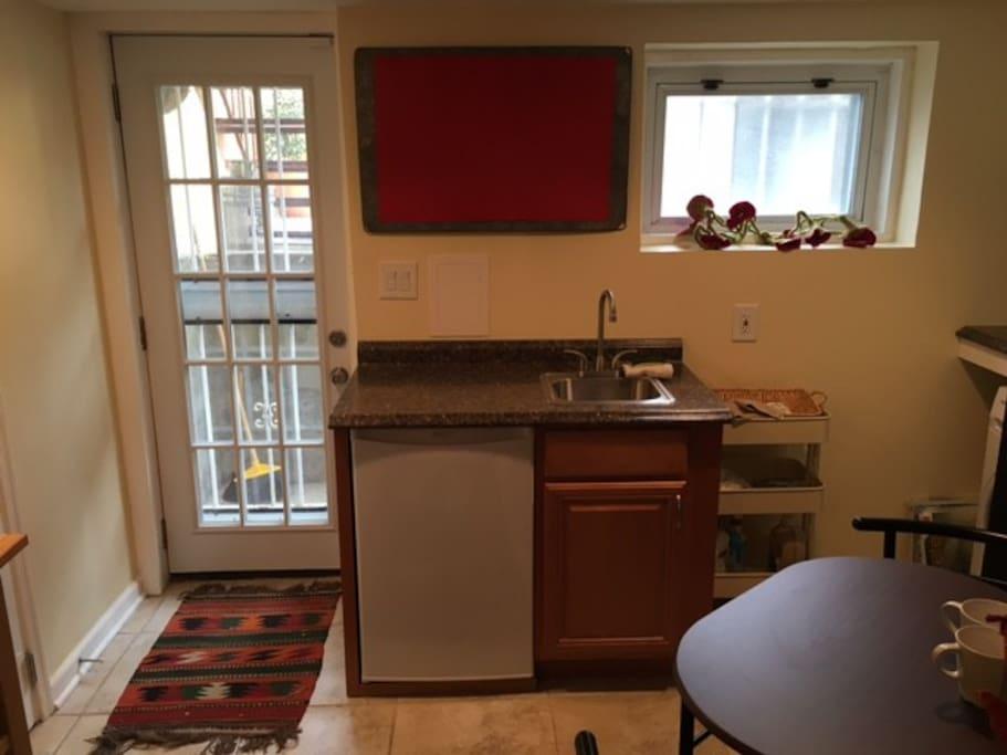 New kitchenette with refrigerator.