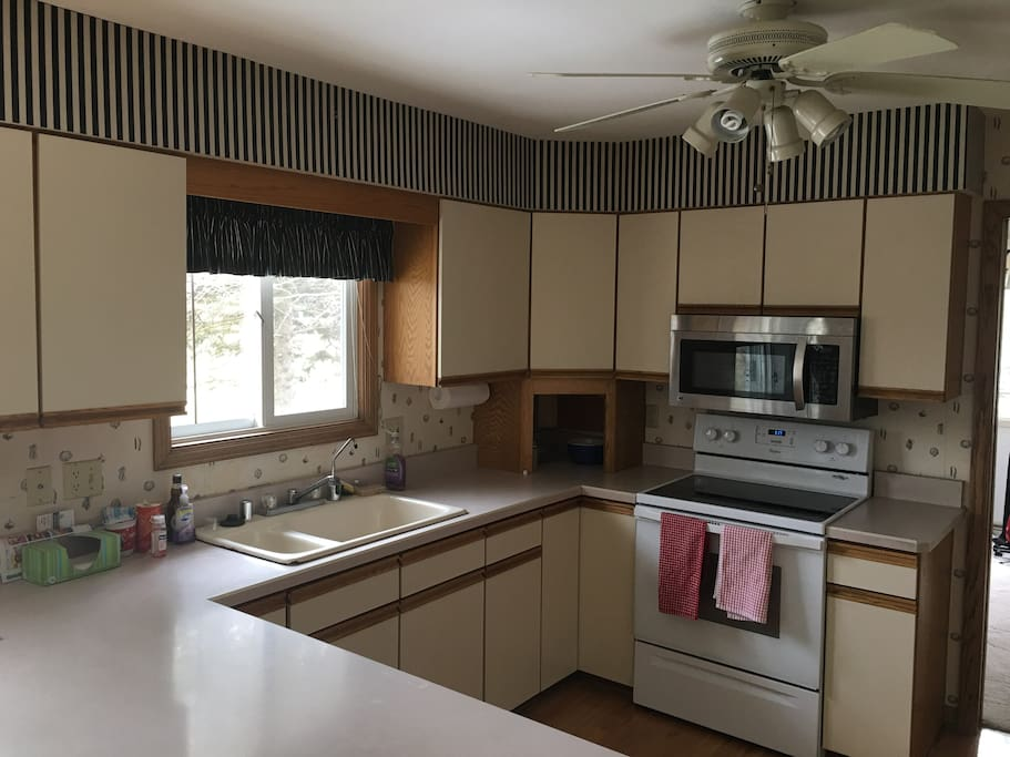 Kitchen with microwave stove dishwasher refrigerator
