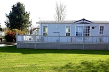 Situated on a large corner plot in a quiet peaceful location.
