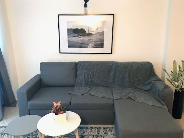 in the living room you will find a corner sofa to relax