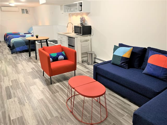 The living area has a queen-size sofa bed (accommodates 2 guests).