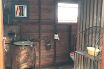 Quirky clean bathroom and you can enjoy the views from the shower!