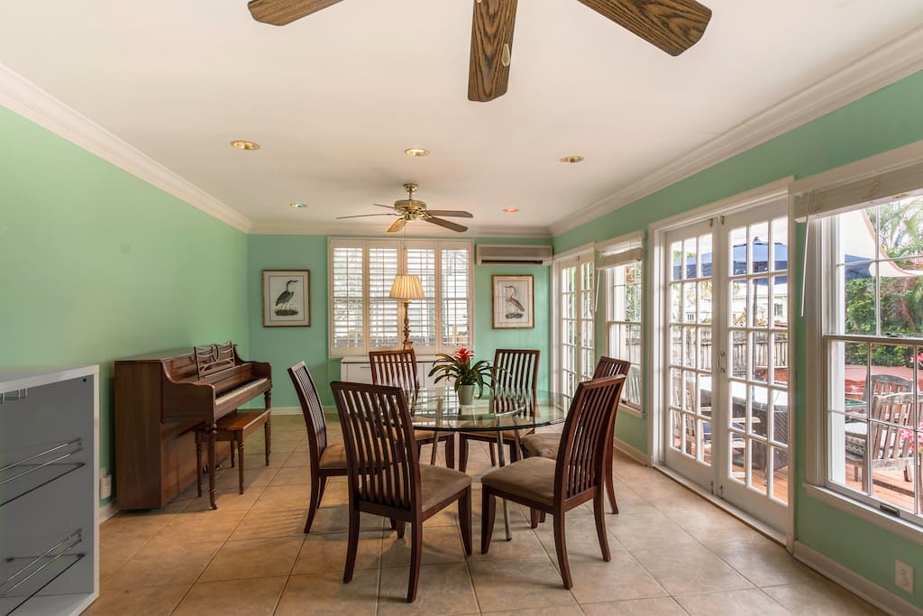Dining room with triple french doors.