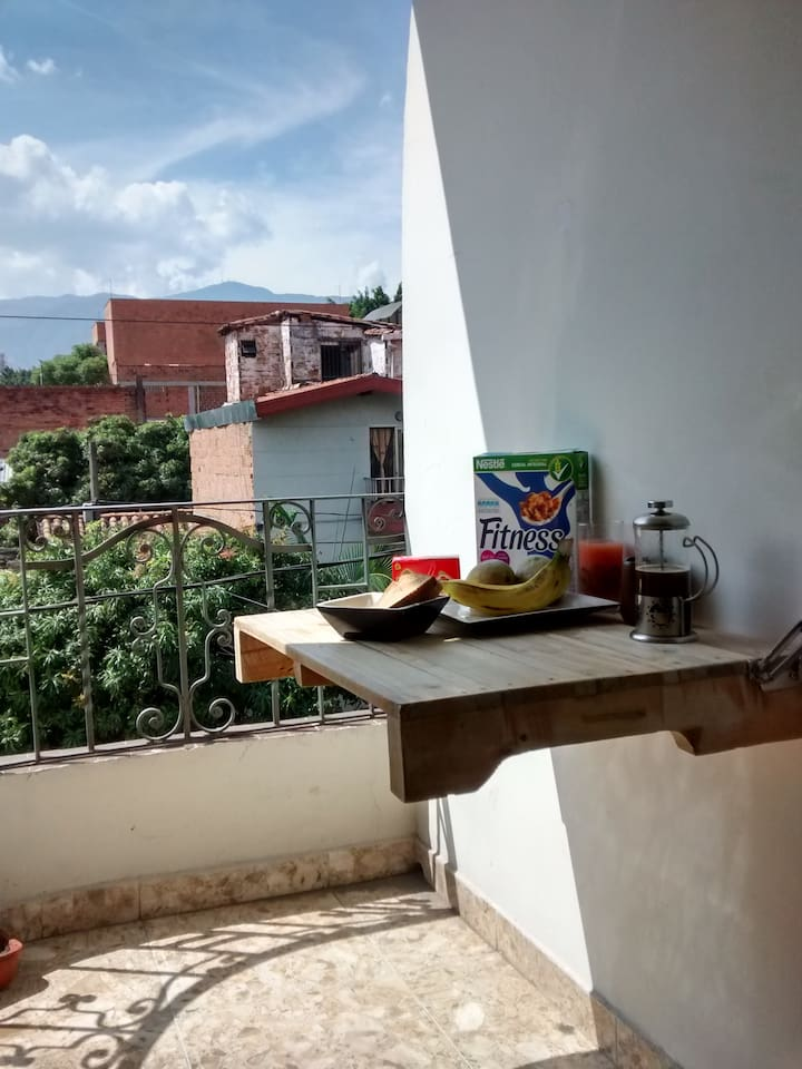 a nice balcony from where you can see the city while enjoying a rich Colombian coffee