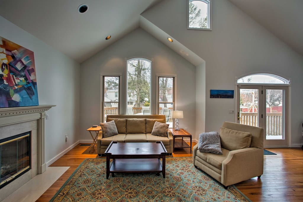 The open-concept floor plan and vaulted ceilings promote a serene ambiance throughout the home.