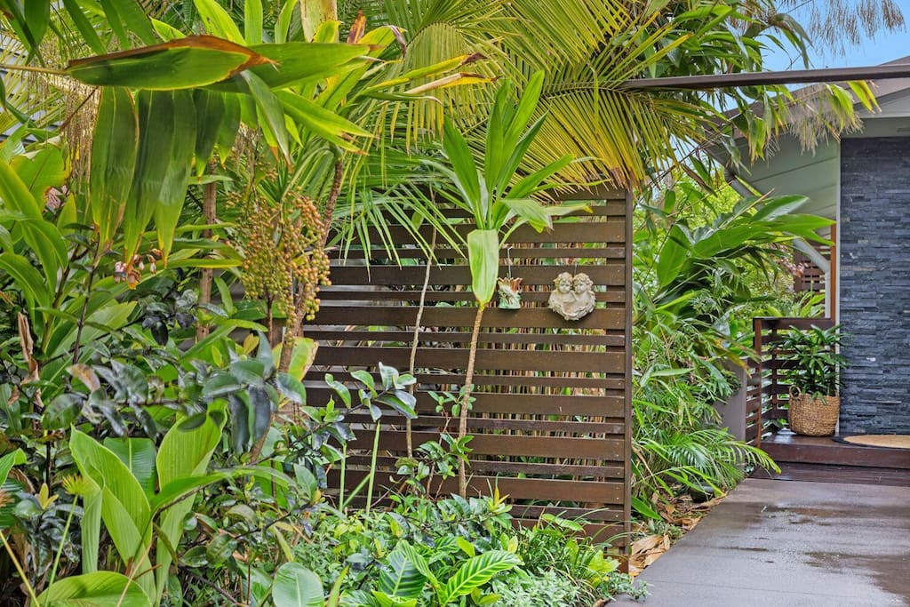 Tropical gardens and gated entrance