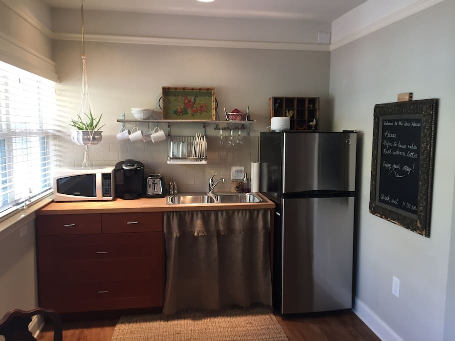 Kitchenette with microwave, fridge, Keurig coffee maker, and microwave.