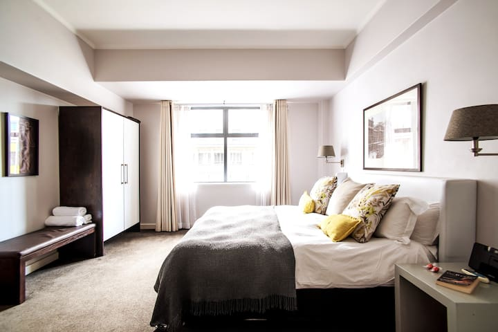 Spacious bedroom with super comfortable king-size bed
