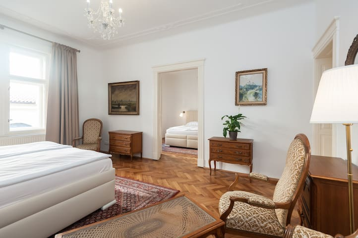 bedroom number 1 with high quality mattresses and beds  & from the windows you will see magnificent Baroque Church of St. James
