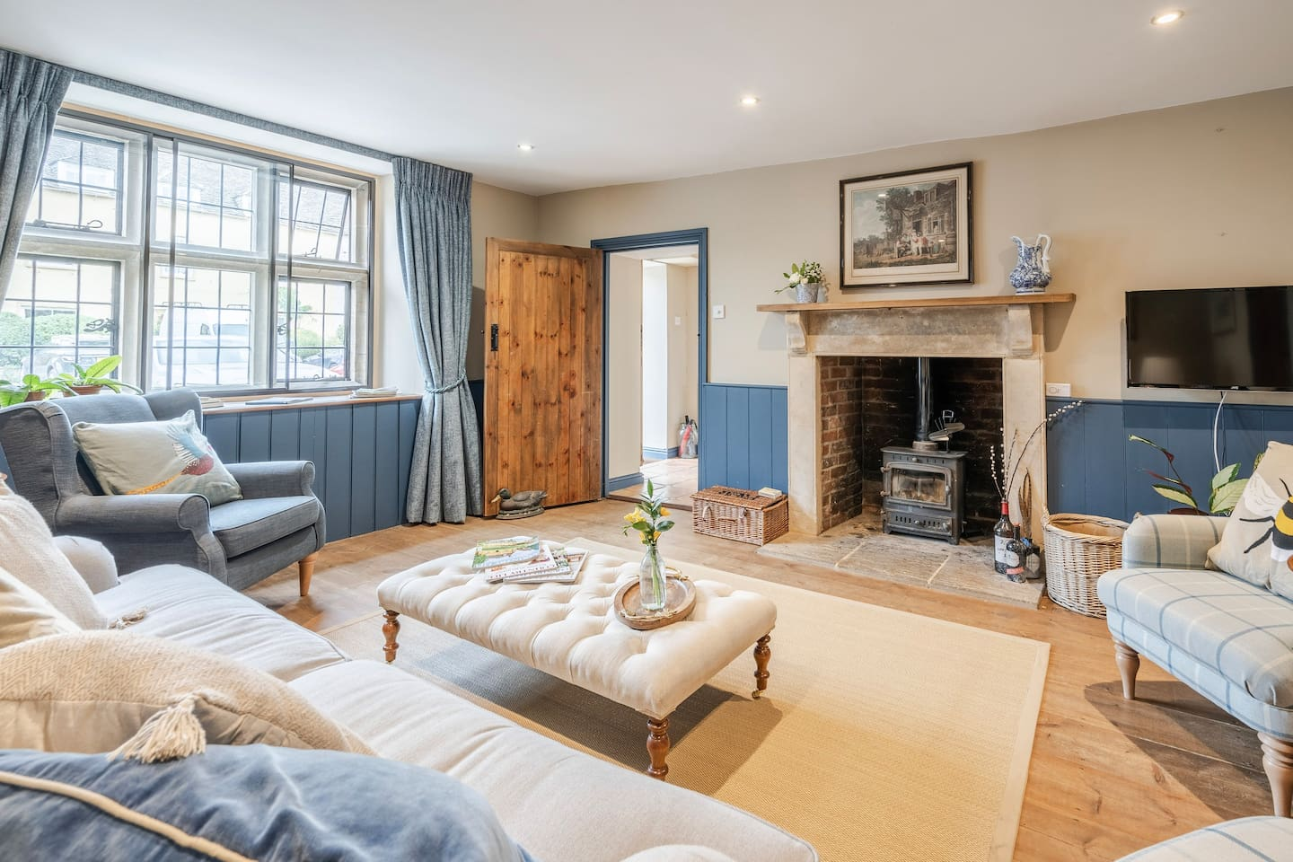 Living room - light and airy in the summer or cosy in the winter with the wood-burner lit!