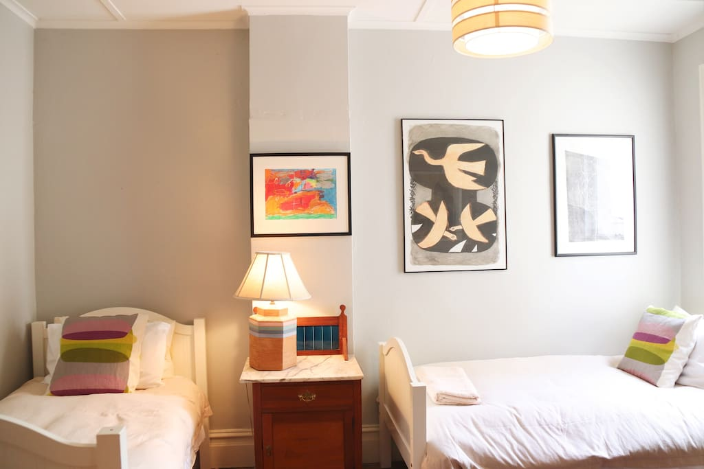 Double bedroom with 2 single beds.